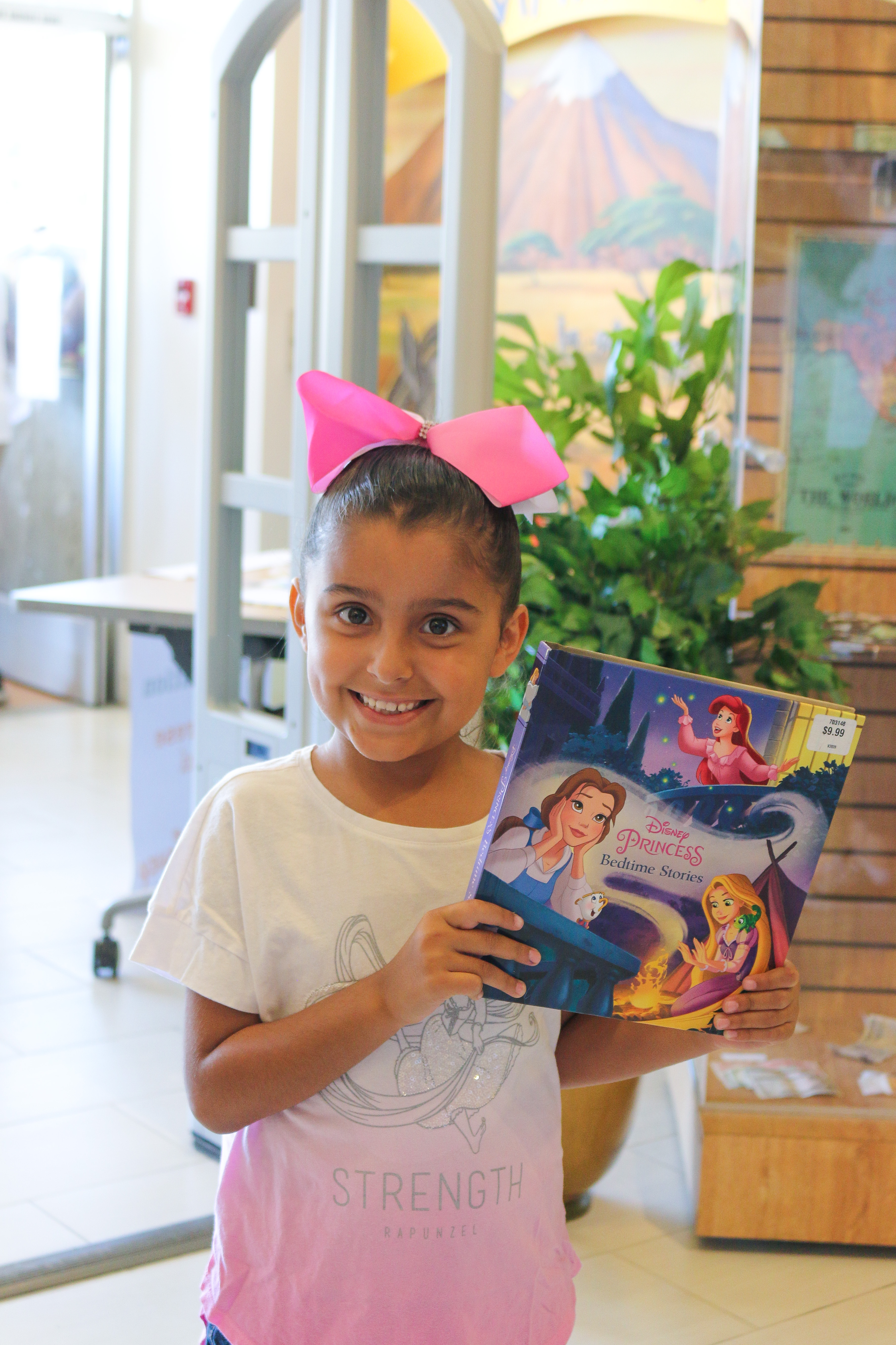 Child holding donation book at Central Library
