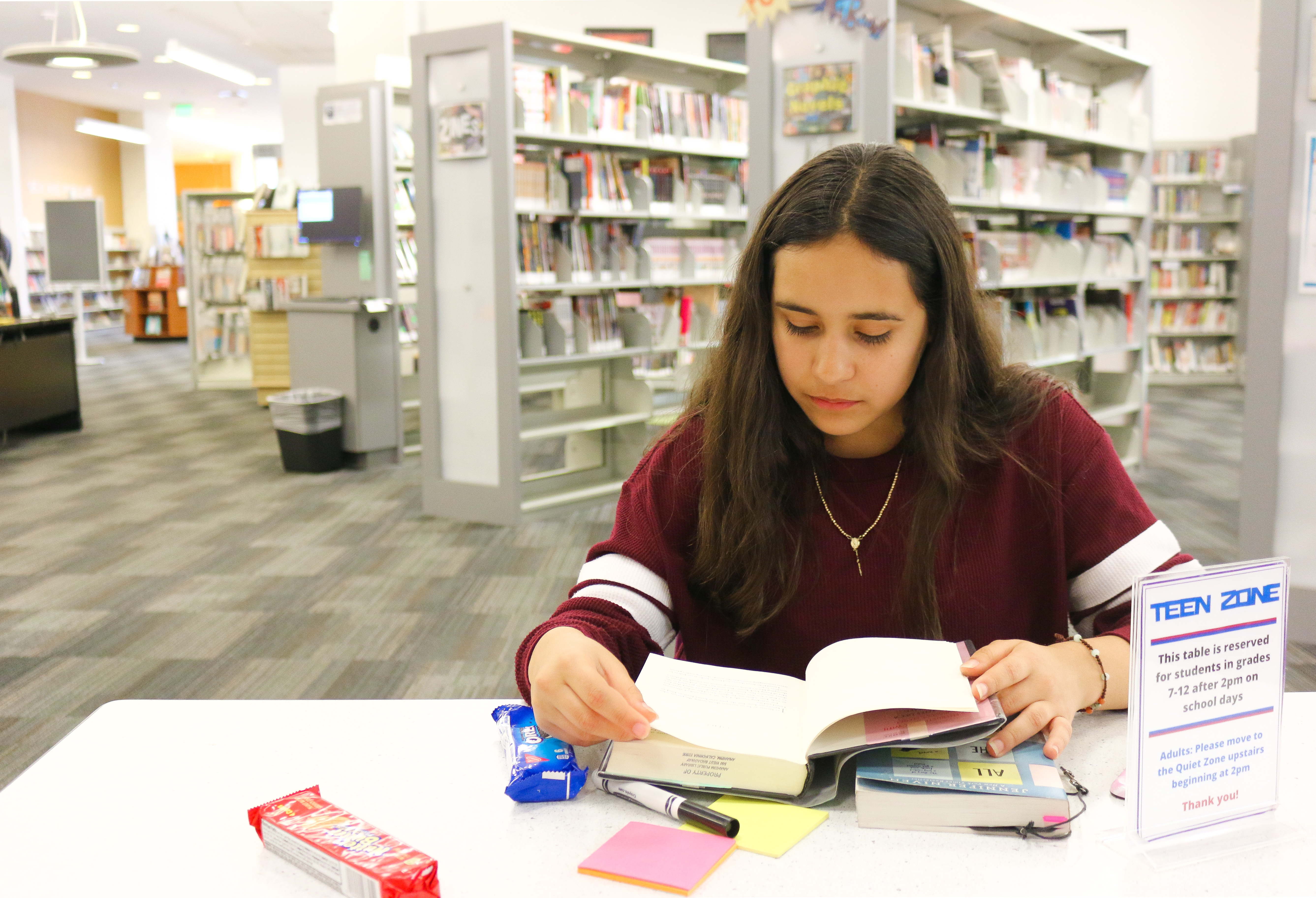 Teen reading in library
